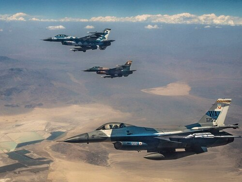 Three F-16 Fighting Falcon fighter jets fly over the Nevada Test and Training Range on July 27, 2018, during Red Flag 18-3. (Airman Bailee A. Darbasie/Air Force))