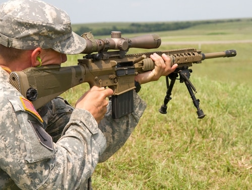 Spc. Joshua Scott, an infantryman of Co. C, 1st Bn., 28th Inf. Regt., 4th IBCT, 1st Inf. Div., fires M110 Semi Automatic Sniper System at a target downrange on Aug. 16. Scott is firing the weapon from the standing position, one of several different firing positions the soldiers are focused on during their one month block of sniper instruction. Instructors from Fort Benning, Ga., traveled to Fort Riley in order to teach the Soldiers of the brigade necessary skills to be effective snipers. (U.S. Army photo by Sgt. Scott Lamberson, 4th IBCT PAO)