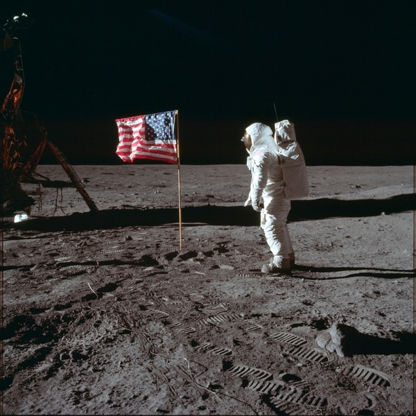 On July 20, 1969, astronaut Buzz Aldrin Jr. poses for a photograph beside the U.S. flag on the moon during the Apollo 11 mission. (Neil Armstrong/NASA via AP)