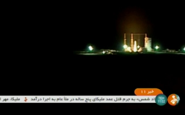 A rocket carrying a Payam satellite is launched at Imam Khomeini Space Center in this image from Iranian state TV. The effort to put the satellite in orbit on Tuesday failed. (IRINN, via AP)