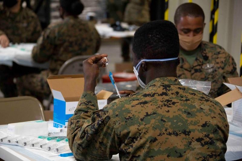 U.S. service members receive the COVID-19 vaccine aboard Marine Corps Air Station Miramar, California, on Jan 29, 2021. (Cpl. Leilani Cervantes/Marine Corps)