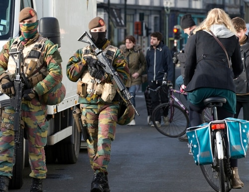 Belgian Army soldiers patrols in the center of Brussels on Monday, Nov. 23, 2015. The Belgian capital Brussels has entered its third day of lockdown, with schools and underground transport shut and more than 1,000 security personnel deployed across the country. (AP Photo/Virginia Mayo)