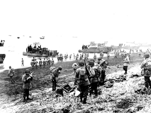 In this May 26, 1943, file photo released by the U.S. Navy, American soldiers and equipment land on the black volcanic beach during World War II at Massacre Bay on Attu Island, part of the Aleutian Islands of Alaska. May 30, 2018 will mark the 75th anniversary of American forces recapturing Attu Island in Alaska's Aleutian chain from Japanese forces. It was the only World War II battle fought on North American soil. (U.S. Navy via AP)