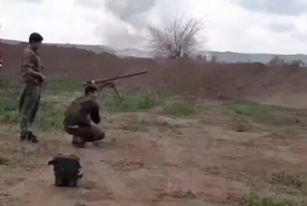 This frame grab from video provided on Tuesday, Feb. 12, 2019, by the Syrian Observatory for Human Rights, an opposition group, that is consistent with independent AP reporting, shows U.S.-backed Syrian Democratic Forces fighters take their position during a battle against Islamic State group militants, in the village of Baghouz, Deir El-Zour, eastern Syria. (Syrian Observatory for Human Rights via AP)