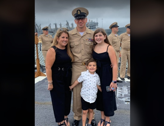 Chief Culinary Specialist Adam Foti, shown here with his wife and kids, died Oct. 16 after being struck by a forklift on the pier at Naval Station Norfolk. (Photo courtesy Brandi Woods-Foti)