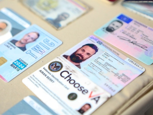 This photo released by the Venezuelan Miraflores presidential press office shows what Venezuelan authorities identify as the the I.D. cards of former U.S. Special Forces soldiers Airan Berry, right, and Luke Denman, left, in Caracas, Venezuela, on May 4, 2020. (Miraflores Palace presidential press office via AP)