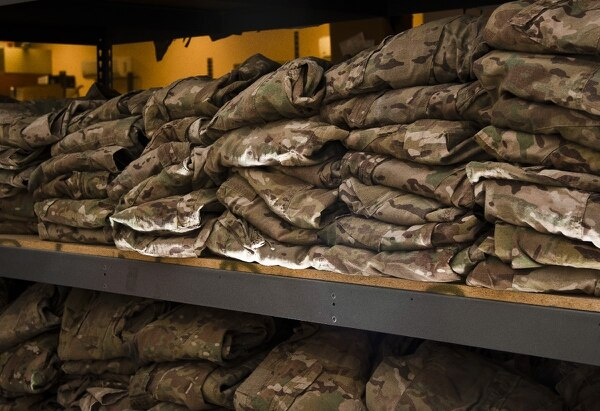 Stacks of recycled Operation Enduring Freedom Camouflage Pattern uniforms await airmen at Bagram Airfield, Afghanistan, July 7, 2012. (Capt. Raymond Geoffroy/Air Force)