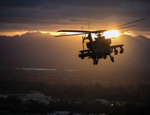 Army AH-64 Apache helicopter flies in formation during a Division Run during Tropic Lightning Week on Schofield Barracks, Hawaii, Dec. 17, 2018. (1st Lt. Ryan DeBooy/Army)