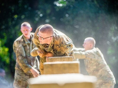 Trainees from Delta Company, 2nd Battalion, 19th Infantry Regiment, train on the Sand Hill Obstacle Course at Fort Benning, Georgia. (Patrick A. Albright, Army)