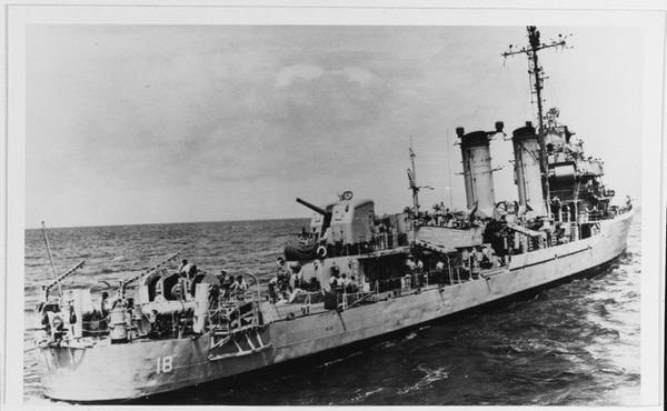 A Navy fast minesweeper wears the bogus hull number DMS - 18 while serving as the ship for the film