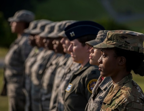 Airmen stand at attention during a retreat ceremony March 30, 2018, on Kadena Air Base, Japan. An all-female formation was coordinated in honor of Women's History Month, which brings attention to the accomplishments and achievements of women throughout history. (Staff Sgt. Micaiah Anthony/Air Force)