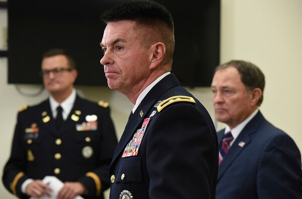 Maj. Gen. Jefferson S. Burton, center, address the media on Sunday, Nov. 4, 2018, in Draper, Utah. (Francisco Kjolseth/The Salt Lake Tribune, via AP)