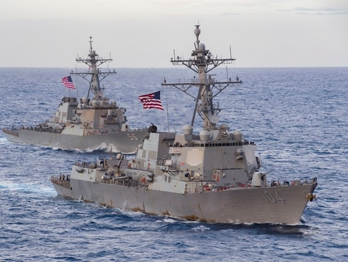 The guided-missile destroyers Sterett and John S. McCain transit the South China Sea Feb. 9. (MC3 Cheyenne Geletka/Navy)