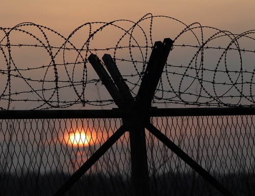 PAJU, SOUTH KOREA - JANUARY 06: A barbed wire fence at a military check point near the demilitarized zone (DMZ) separates South and North Korea on January 6, 2016 in Paju, South Korea. North Korea confirmed it has conducted a hydrogen bomb test after South Korea's Metrological Administration detected an 'artificial earthquake' near Punggye-ri, North Korea's main nuclear testing site on January 6, 2015. (Photo by Chung Sung-Jun/Getty Images)