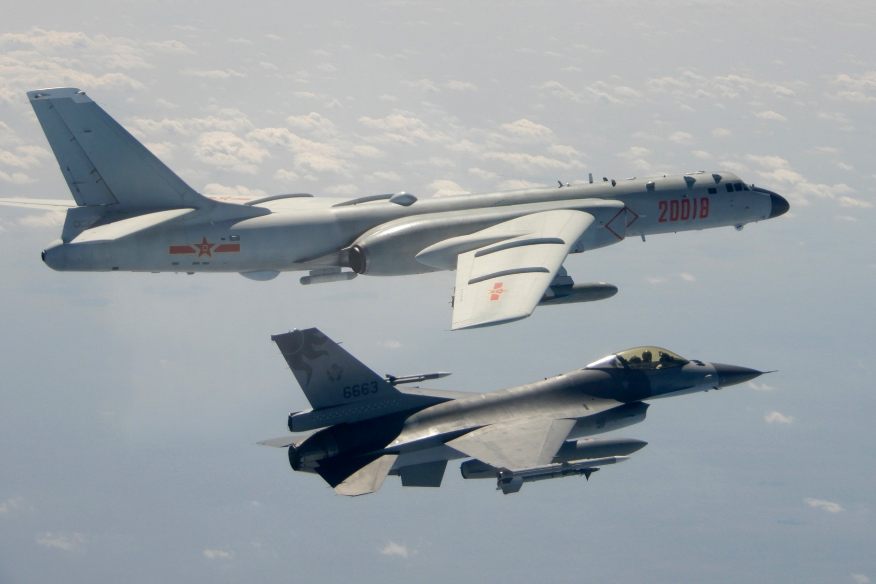 In this Feb. 10, 2020, image released by Taiwan's government, a Taiwanese Air Force F-16, foreground, flies on the flank of a Chinese H-6 bomber as it passes near the island. (Taiwanese Ministry of National Defense via AP)