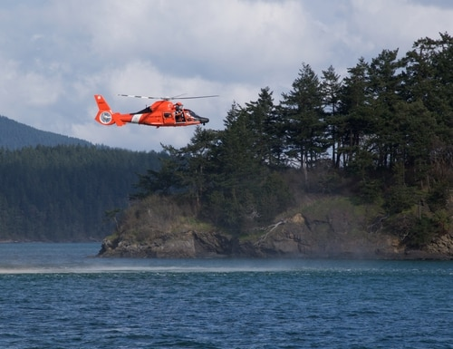 An Coast Guard MH-65 helicopter conducts training in the Pacific Northwest, Mar. 1, 2018. (DoD) U.S. Coast Guard photo by Petty Officer 2nd Class Adrian Diel.