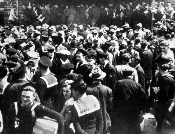 Service men and civilians crowd about a brewery in Halifax, Nova Scotia, Canada on May 8, 1945, which was looted during V-E Day violence. (AP)