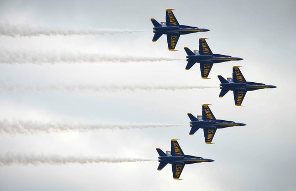 The U.S. Navy Flight Demonstration Squadron, the Blue Angels, fly in formation over Lake Washington while performing at an airshow Aug. 6, 2016, during Seattle's 67th annual Seafair Fleet Week. (MC3 Erickson B. Magno/Navy)
