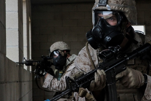Marines with 1st Battalion, 7th Marine Regiment provide security in a simulated combat town during the culminating event of Division School's Urban Leaders Course aboard Camp Pendleton, Calif. (Lance Cpl. Danielle Rodrigues/Marine Corps)