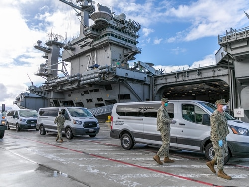 The carrier Theodore Roosevelt in port in Guam. Legal experts told Defense News that outside agencies should be conducting the investigations into the circumstances that led to the relief of the ship's commanding officer. (U.S. Navy photo by MCC Matthew White)