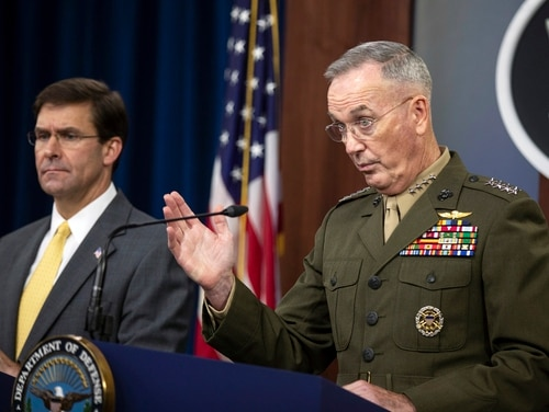 Joint Chiefs Chairman Gen. Joseph Dunford with Secretary of Defense Mark Esper speaks to reporters during a briefing at the Pentagon, Wednesday, Aug. 28, 2019. (Manuel Balce Ceneta/AP)