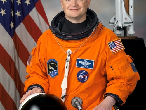 In this April 3, 2008 photo provided by NASA, astronaut Eric Boe poses for a photo. Boe is one of four veteran astronauts selected to fly the first commercial space missions, NASA announced, Thursday, July 9, 2015. (NASA via AP)