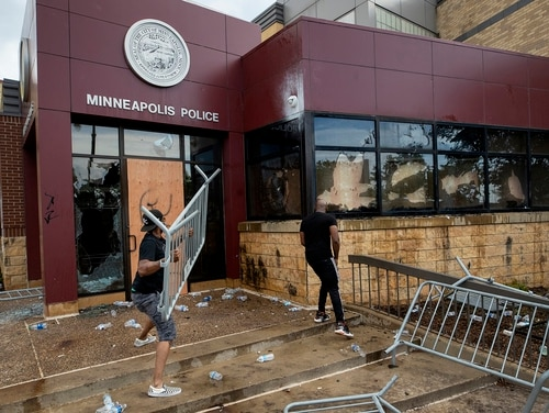 Protesters damage properties at the Minneapolis 3rd Police Precinct in Minneapolis on Wednesday, May 27, 2020. (Carlos Gonzalez/Star Tribune via AP)