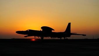 A U.S. Air Force U-2 Dragon Lady from the 99th Expeditionary Reconnaissance taxis to it's parking spot at an undisclosed location in Southwest Asia, Dec. 2, 2010. The U-2 utilizes a chase vehicle to assist with both takeoff and landing.