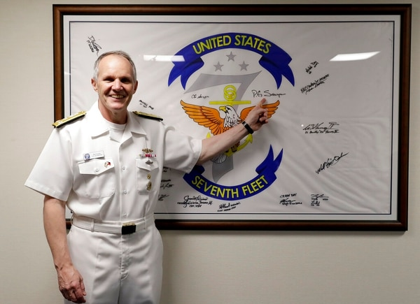 U.S. Vice Adm. Phillip Sawyer, commander of the 7th Fleet, points to his autograph on his fleet's flag, which is displayed aboard the flagship Blue Ridge, during an interview aboard the vessel on Monday at Manila's South Harbor. The flag was was planted on Mt. Everest and is now displayed on board his flagship. (Bullit Marquez/AP)