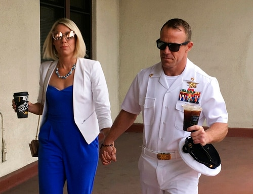 "Special Warfare Operator Chief Edward ""Eddie"" Gallagher, right, walks with his wife, Andrea, as they arrive at the courtroom inside Naval Base San Diego on Wednesday. (Julie Watson/AP)"