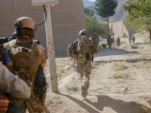 U.S. and Romanian Special Forces soldiers, attached to Special Operations Task Force-Afghanistan, move while under fire from the Taliban while on patrol during an operation in Afghanistan last year. (U.S. Army photo by Sgt. Connor Mendez/Reviewed)