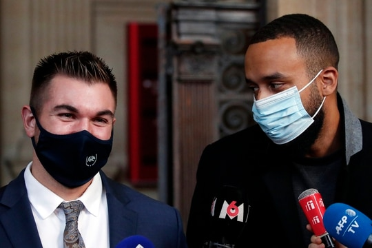 Alek Skarlatos, left, and Anthony Sadler, right, deliver a speech during the Thalys attack trial at the Paris courthouse, Friday, Nov. 20, 2020. (Francois Mori/AP)