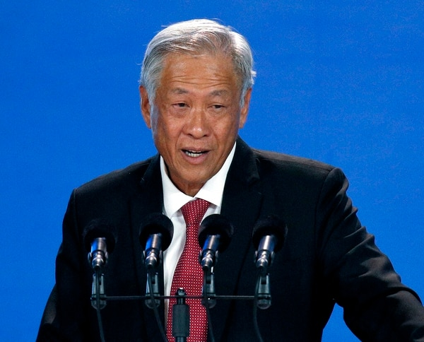 """In this Oct. 25 photo, Singapore's Defense Minister Ng Eng Hen speaks during the Xiangshan Forum, a gathering of the region's security officials, in Beijing. Ng said Saturday at the Munich Security Conference in Germany that confidence building measures were helping """"minimize the risk of miscalculations and build trust and confidence among militaries."""" (Andy Wong/AP)"""