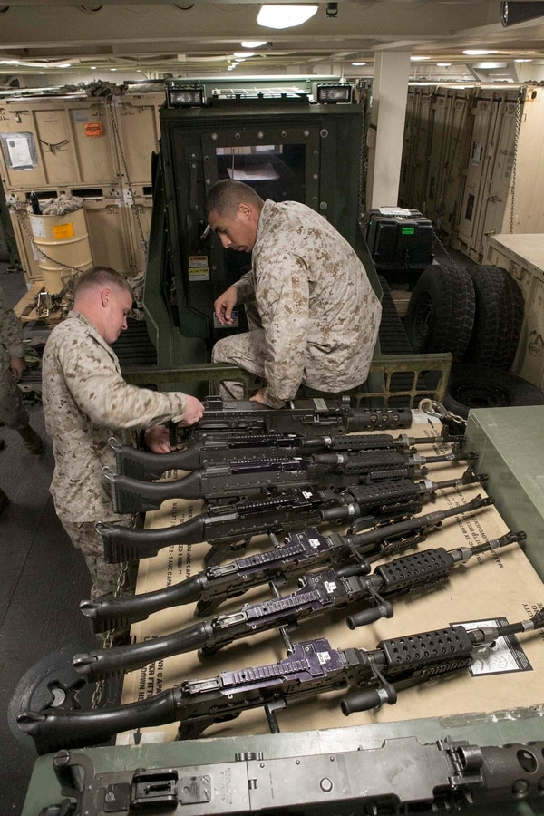 U.S. Marines with Echo Battery, Battalion Landing Team 2/6, 26th Marine Expeditionary Unit, embarked aboard the amphibious transport dock ship USS Arlington (LPD 24), re-assemble a .50-caliber machine gun during a gear inspection in the Arabian Gulf, Jan. 27, 2015. The 26th MEU is embarked with the Kearsarge Amphibious Ready Group and is deployed to maintain regional security in the 5th Fleet area of operations. (U.S. Marine Corps photo by Sgt. Austin Long/Released)