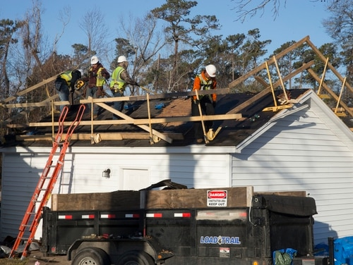 Repairmen remove shingles damaged during a hurricane last fall from a home in Paradise Point housing on Marine Corps Base Camp Lejeune, N.C., on Feb. 1, 2019. Lawmakers on Capitol Hill will hold a series of hearings this week to look into problems with the quality of military housing and privatization of those residences. (Lance Cpl. Ginnie Lee/Marine Corps)