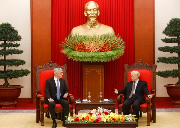 In this Jan. 25 photo, U.S. Secretary of Defense Jim Mattis, left, listens during talks with Vietnam's Communist Party General Secretary Nguyen Phu Trong in Hanoi, Vietnam. Mattis is planning to make his second visit to Vietnam this year, signaling how vigorously the Trump administration is trying to counter China's military assertiveness in the South China Sea by building up relations with smaller nations in the region. (Tran Van Minh/AP)
