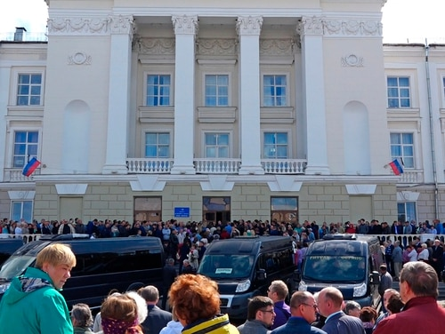 In this grab taken from a footage provided by the Russian State Atomic Energy Corporation ROSATOM press service, people gather for the funerals of five Russian nuclear engineers killed by a rocket explosion in Sarov. (Russian State Atomic Energy Corporation ROSATOM via AP)