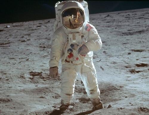 On July 20, 1969, astronaut Buzz Aldrin, lunar module pilot, walks on the surface of the moon during the Apollo 11 extravehicular activity. (Neil Armstrong/NASA via AP)