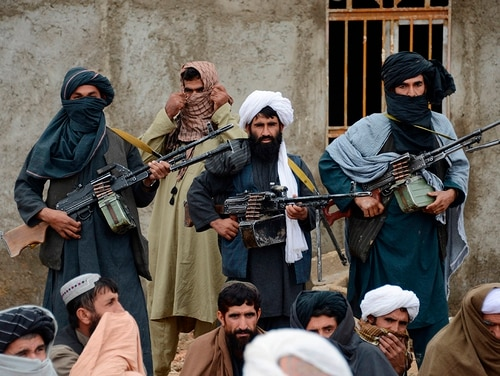 In this Nov. 3, 2015, file photo, Afghan Taliban fighters listen to Mullah Mohammed Rasool, the newly elected leader of a breakaway faction of the Taliban, in Farah province, Afghanistan. (AP)