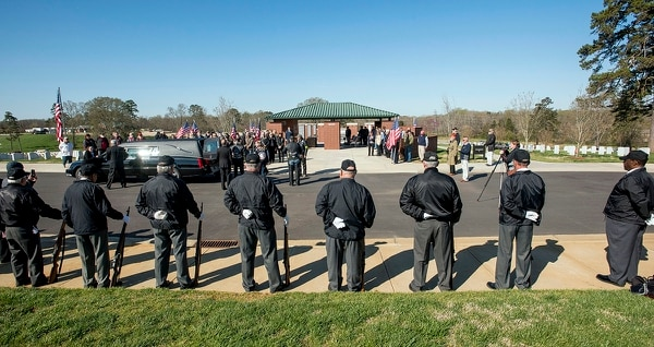 This photo take April 3, 2019, shows the Rowan Veterans Honor Guard taking part in the burial. US Army medic Phillip Kenneth Drye, a veteran of the Vietnam War, was buried at the Salisbury National Cemetery in Salisbury, N.C. Drye passed away on Dec. 24, 2018, but had no relatives to claim the body and pay for his funeral. (Jon C Lackey/The Salisbury Post via AP)