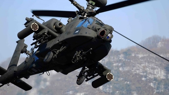 An AH-64 Apache helicopter like this one crashed Saturday at the National Training Center at Fort Irwin, Calif. Both aviators on board were killed. (Army)
