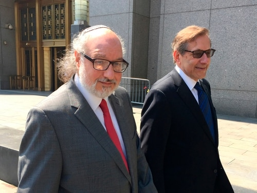 In this July 22, 2016, file photo, convicted spy Jonathan Pollard, left, with his lawyer, Eliot Lauer, leaves federal court in New York following a hearing. (Larry Neumeister/AP)