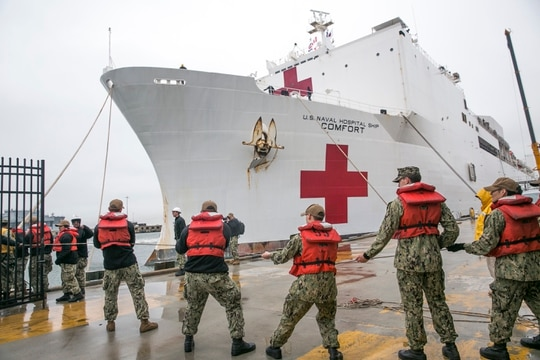 The hospital ship Comfort departed for New York Saturday amid concerns over its COVID-19 screening process. (Jennifer Hunt/Navy)