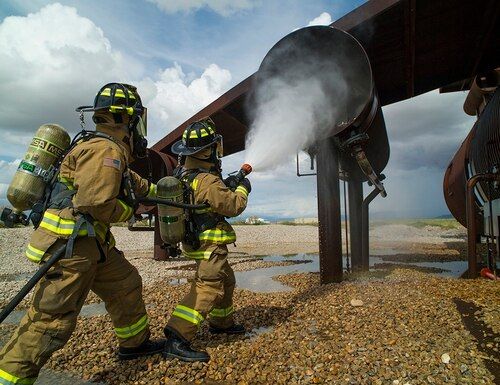 Ffirefighters extinguish a simulated No. 3 engine fire during capability demonstration of the P-34 Rapid Intervention Vehicle at Holloman Air Force Base, N.M., Sept. 21, 2014. (Airman 1st Class Aaron Montoya/Air Force)