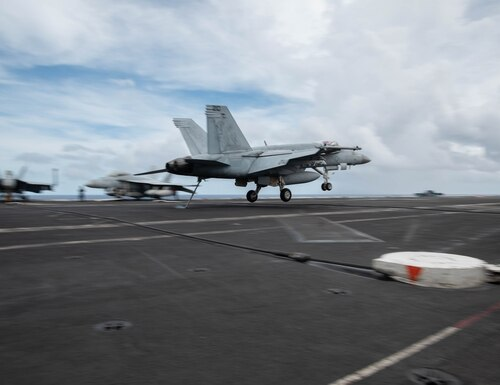 An F/A-18E Super Hornet lands on the aircraft carrier Ronald Reagan earlier in June. (Navy)