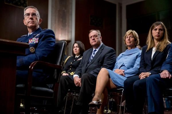Gen. John Hyten, left, accompanied by members of his family, including his wife Laura, second from right, and his daughter Katie, right, appears before the Senate Armed Services Committee on Capitol Hill in Washington, Tuesday, July 30, 2019, for his confirmation hearing to be vice chairman of the Joint Chiefs of Staff. (Andrew Harnik/AP)