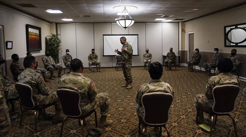 Sergeant Major of the Army Michael Grinston, center, gets feedback from soldiers about their concerns at Fort Hood, Texas, Thursday, Jan. 7, 2021.