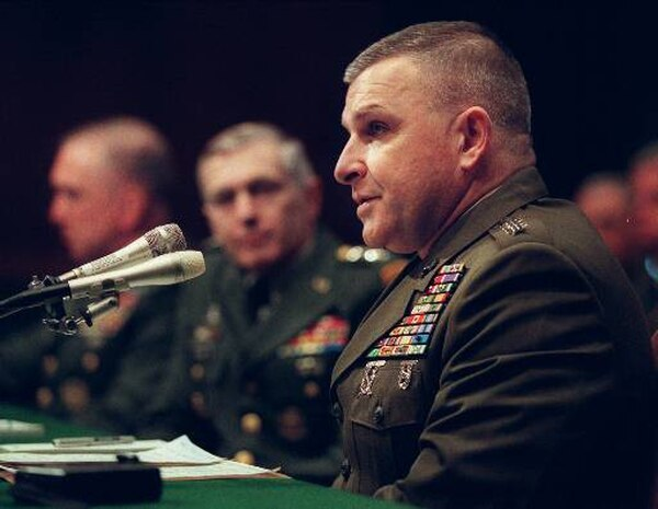 Retired Marine Gen. Anthony Zinni, right, then-commander-in-chief, Central Command, testifies on Capitol Hill, Tuesday, March 3, 1998, before the Senate Armed Service Committee hearing on military strategy and operational requirements. (Tyler Mallory/AP)