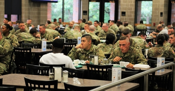 Service members at the dining facility Fort McCoy, Wis. Experts say healthy eating choices have to start young if the Army is going to be able to find enough recruits who meet weight requirements. (Scott T. Sturkol/Army)