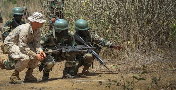 Marine Sgt. Bryan Ballard, an infantryman and class instructor with India Co., 3rd Bn., 23rd Marine Regiment, observes Senegalese Soldiers as they point out a potential simulated Improvised Explosive Device. The unit trained Soldiers from different nations in various techniques and procedures for detecting and reacting to IEDs during Exercise Western Accord. Exercise Western Accord is a U.S. Africa Command sponsored annual joint training partnership exercise between the United States, the Economic Community of West African States and partner nations. The exercise, held in Senegal this year, is designed to increase interoperability between military forces and ensure the common ability to conduct peace operations throughout western Africa. (Photo by U.S. Army Staff Sgt. V. Michelle Woods/ 40th PAD.)